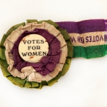 Rosette in WSPU colours, copyright North Herts Museum